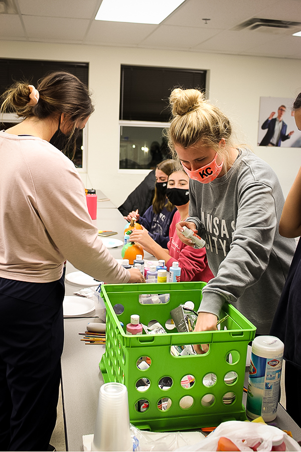 A group gathered their supplies before getting started with their pumpkin projects. Mungano partnered with Zeta Tau Alpha to host this event.