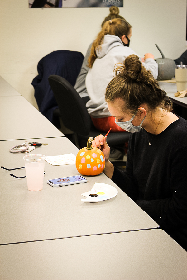 Freshman Taylor Nicholson worked diligently on painting her pumpkin.