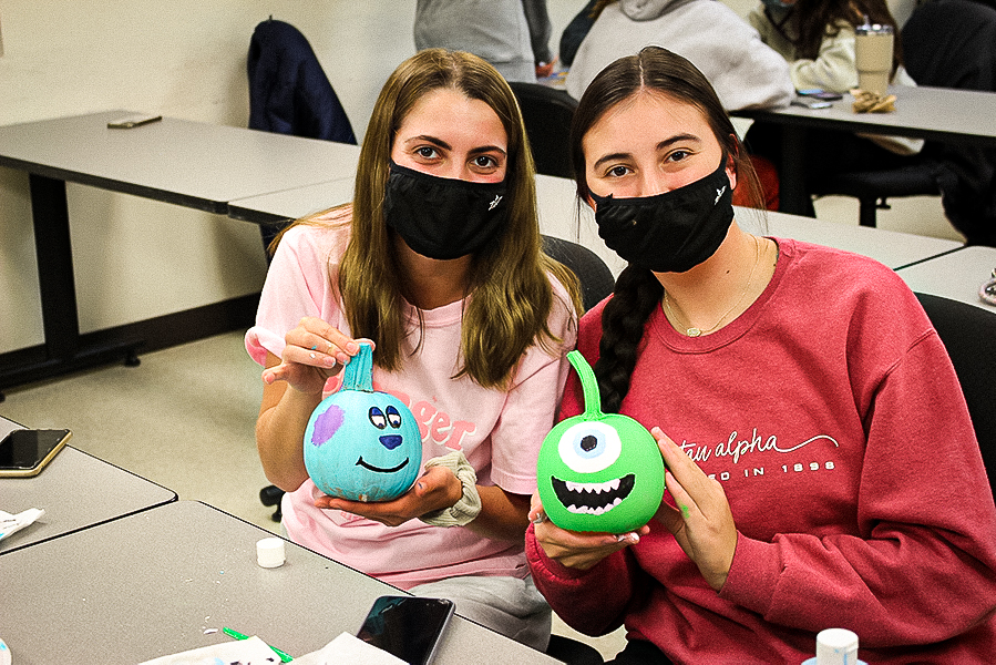 Sophomores Grace Walker and Taylor Kile painted pumpkins resembling the Monster's Inc. dynamic duo.