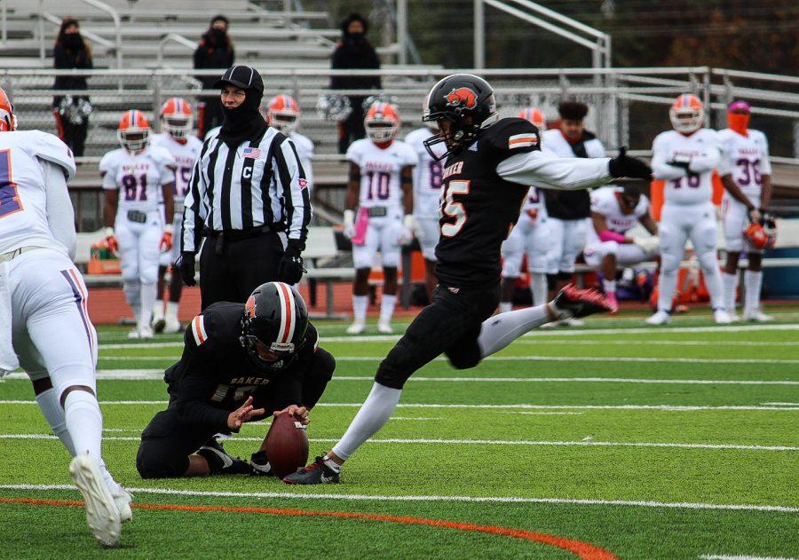 Kicker Devin DeRousse kicks a field goal.