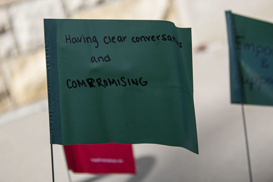 The group used red and green flags to illustrate the signs of healthy and dangerous relationships.