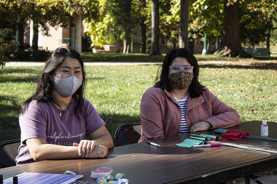 Alpha Chi Omega member Dani Hoff and PACE intern Belinda Flores volunteered to educated students about Domestic Violence Awareness.