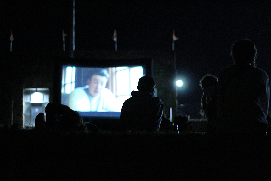 "Baker students watch ""Knives Out"" from the edge of Liston Stadium's parking lot."