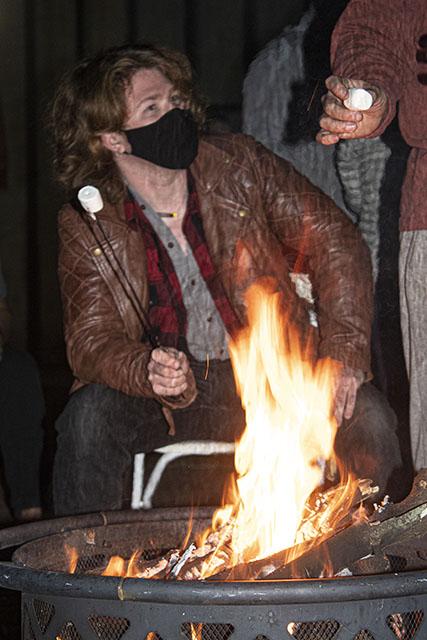 Freshman Liam Flake joins friends in roasting marshmallows.