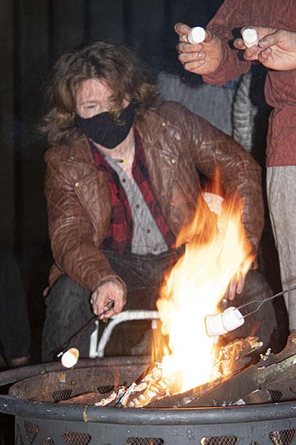 Freshman Liam Flake joins friends in roasting marshmallows