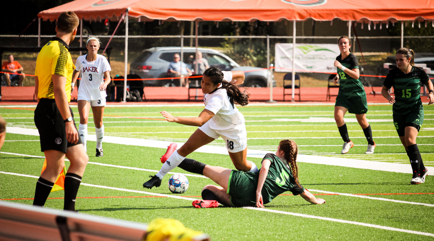 Sophomore Anna Chieu stops at nothing to secure possession for the Wildcats.