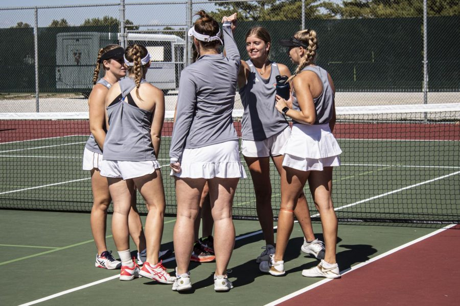 Women's tennis celebrates after their doubles win against Missouri Valley