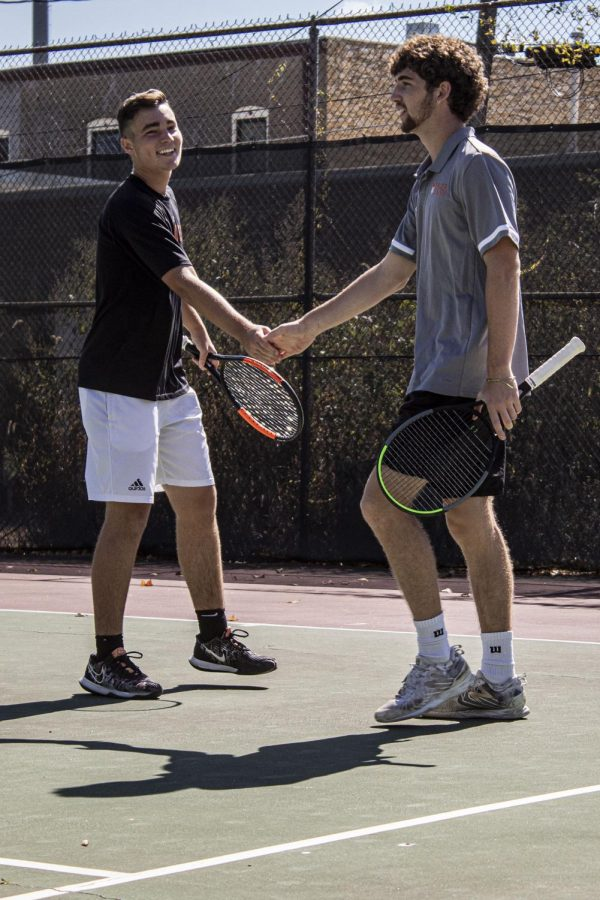 Freshmen doubles partners Davis Steadman and Jacek Holroyd celebrate between points.