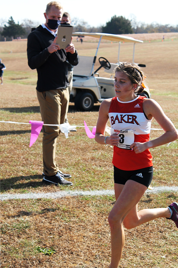 Senior Emily Chambers finishes her 5k race. Chambers finished 5th place overall, receiving All Conference.