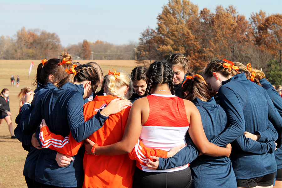 The women's team huddles before their morning race. The women's team placed 2nd overall, gaining a spot in nationals.