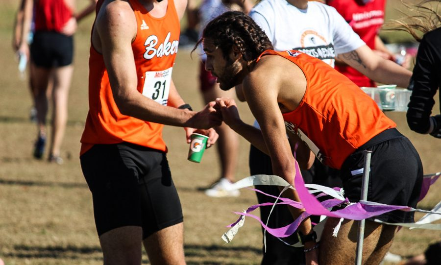 Senior Grant Roesner and Junior Sais Ruiz congratulate each other on their finish.