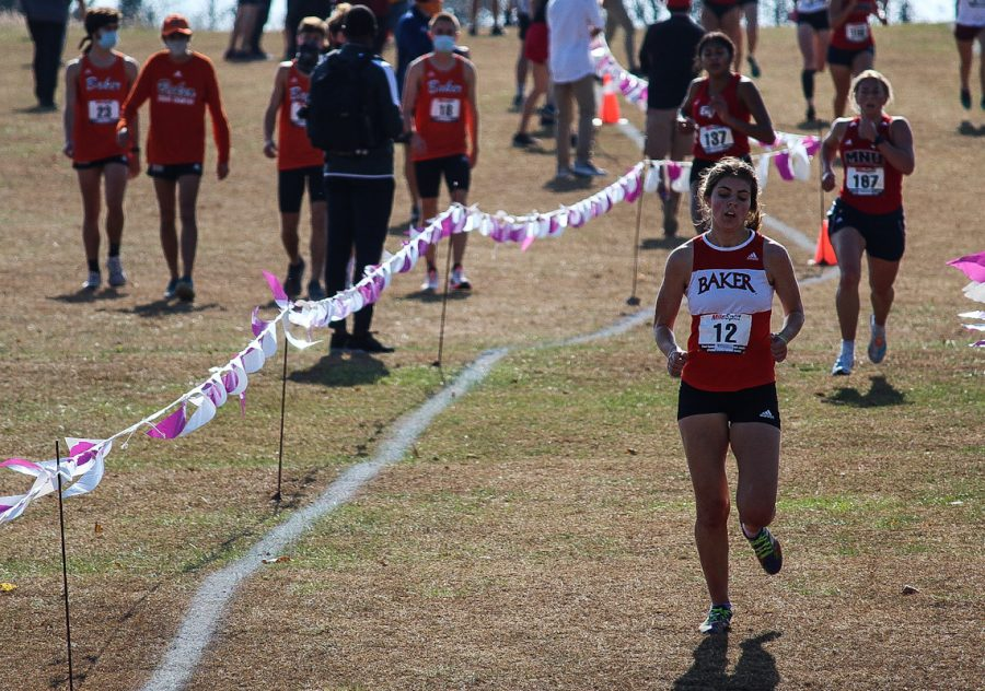 Freshman Evelyn Roesner hustles to the finish line.