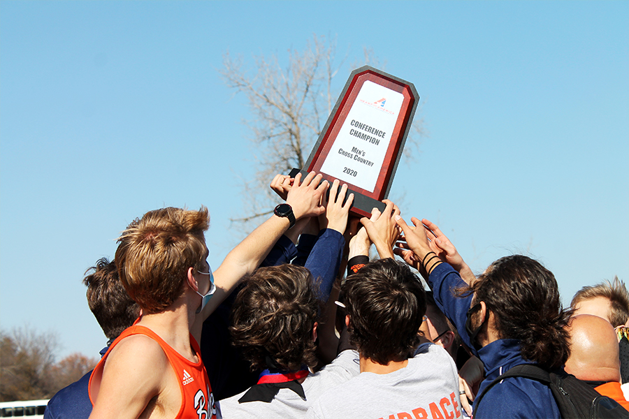 The men's cross country team celebrates their conference win. Both the men and women's team qualified for nationals.