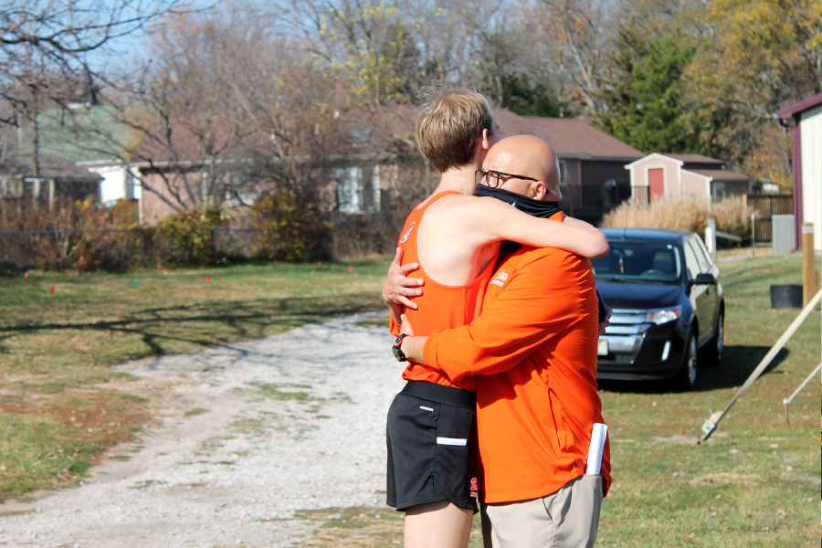 Sophomore Jackson Caldwell and Head Coach Byers hug before the awards. Caldwell got 1st place in the men's division and Byers received Coach of the Year for the 2nd year in a row.