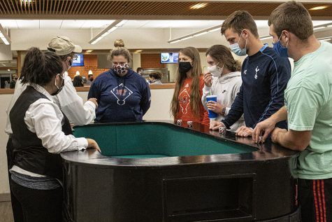 Students gather around a Craps table ready to play.
