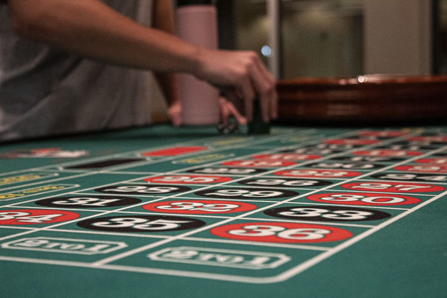 Students place their bets in a game of Roulette.