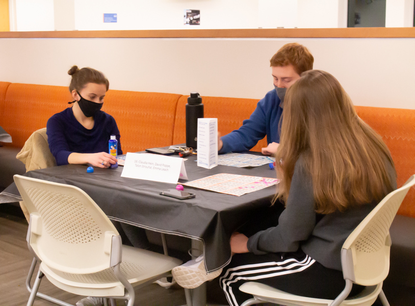 Talon Strouhal (left), David Poppe (middle), and Claudia Hein (right) playing bingo together.