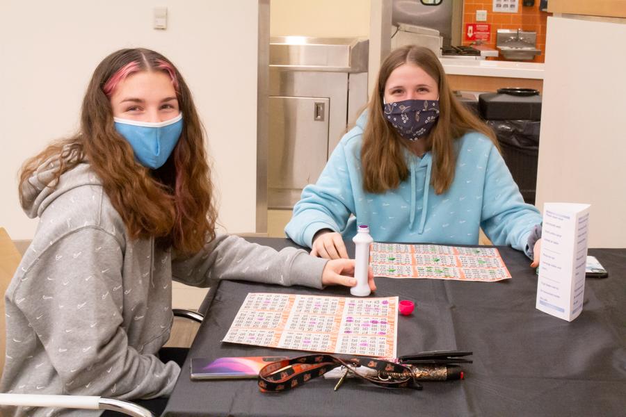 Freshmen Lilyan Rodriguez and Kylie Guerrein play bingo together.