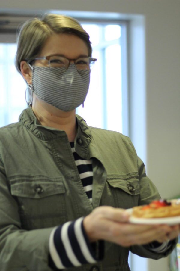 Assistant Professor of Chemistry Molly Anderson takes a waffle to-go.