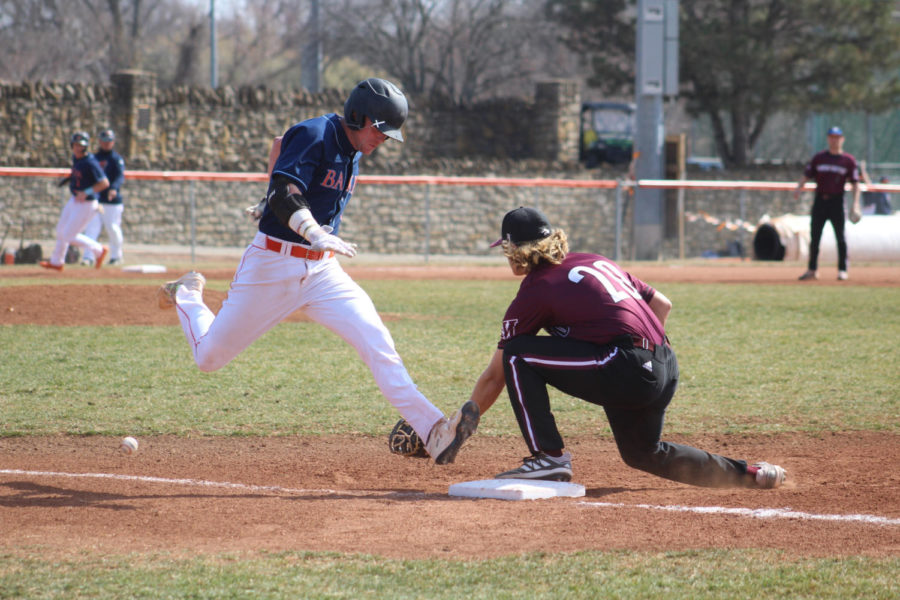 Sophomore Ryan Wetzel is called safe as he beats the ball to first base.