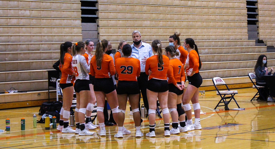 Head Coach Matt Windle talks to the team during a timeout. Unable to find their way back, the team lost the match 0-3.