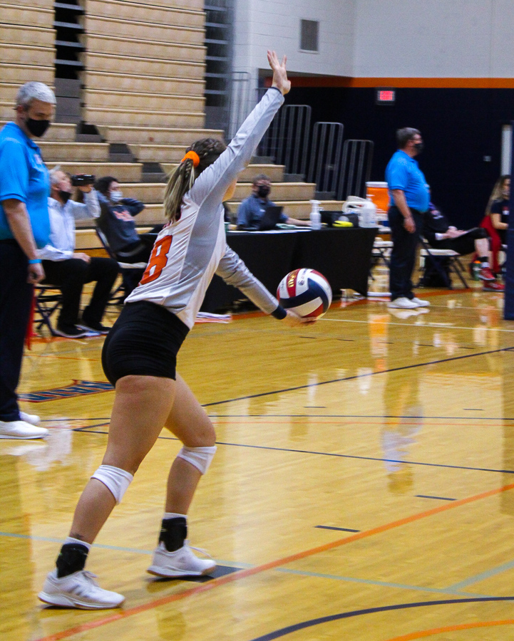 Jordyn Hasbrouck, junior defensive specialist, getting ready to toss her ball up to serve.