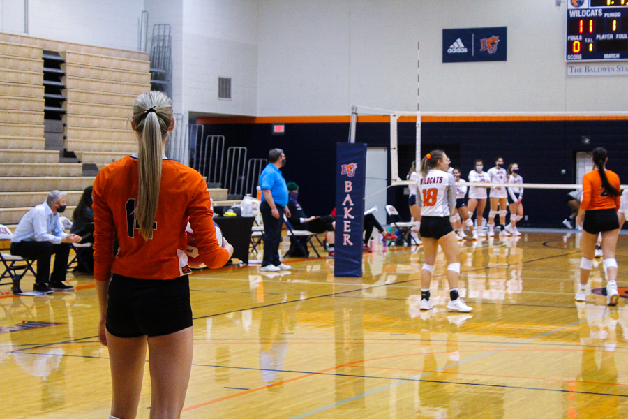 Junior Outside Hitter Kelsey Simmons waiting for the call to serve.