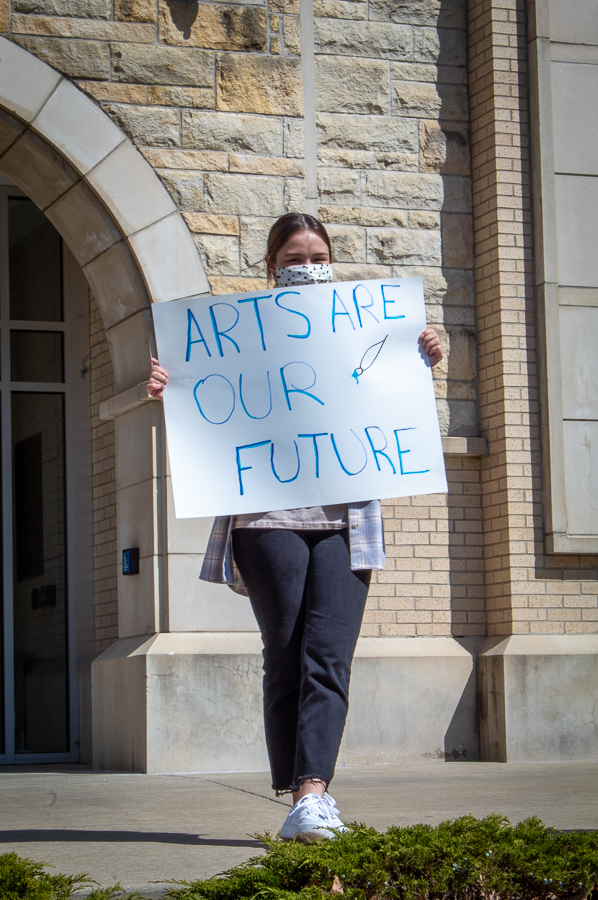 """Senior Emma Smith participated in the budget cut protest at Hartley Plaza on Mar. 26 with a sign stating, """"arts are our future."""""""