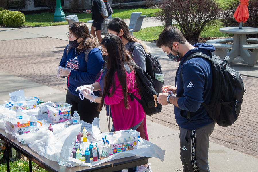 Freshmen Martha Vizcarra, Daphne Jaquez and Johana Cruz-Mera and Junior Zach Ray were among many of the students eager to tie-dye a mask. Student interest was strong after the event got moved twice due to weather.