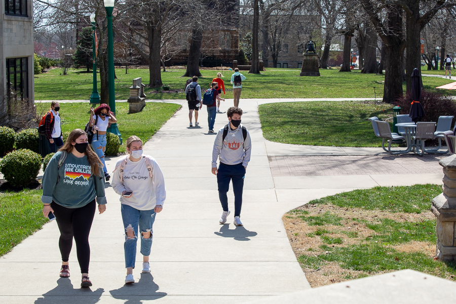 The protest at Hartley Plaza captures many students' attention as they walk by after class.