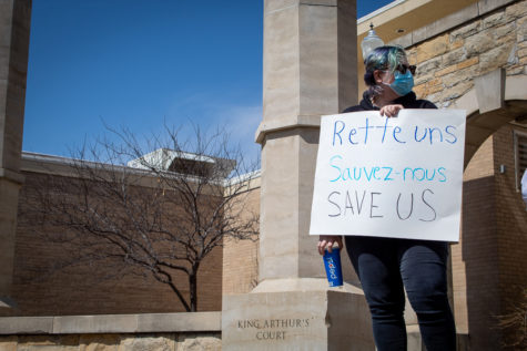 Sophomore Kathryn Harman joined the protest on the Hartley Plaza to show her frustration with recent cuts in offered majors.
