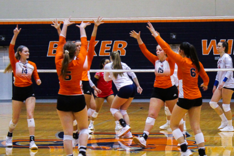 Wildcat volleyball players come together after scoring a point. The team went up against MidAmerica Nazarene on Mar. 23.