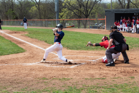 Junior Daniel Bryant takes a swing during the double-header against MidAmerica Nazarene on April 9.