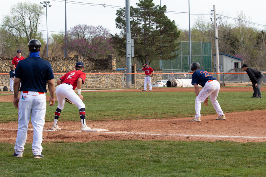 Sophomore Donovan Sutti leads off from first base.
