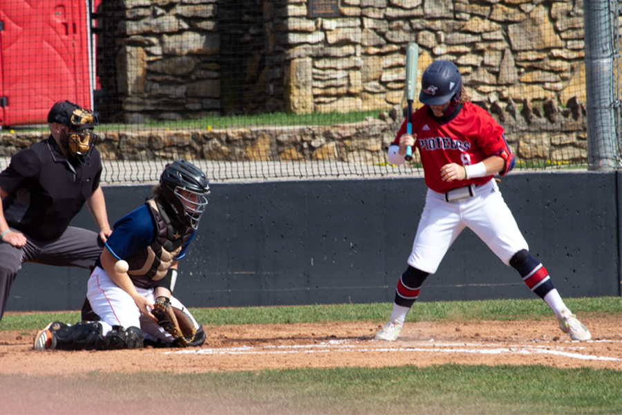 Catcher Brian Hawkins stops a loose ball.