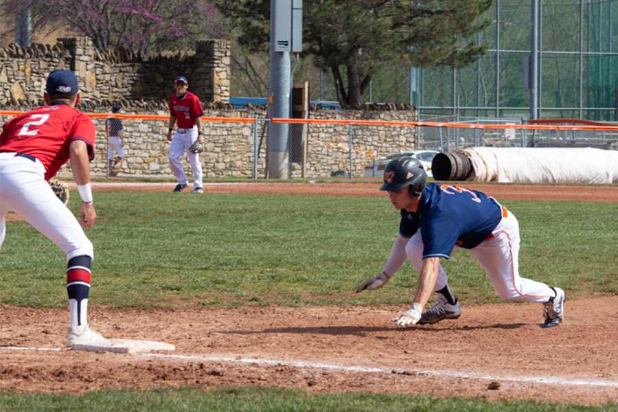 Sophomore Jared Parenti dives back to first as the ball heads toward the base.