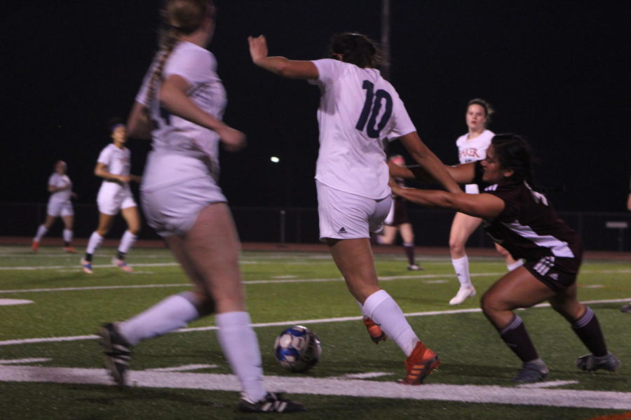 Sophomore Valerie Aceves Power battles with Evangel for the ball.