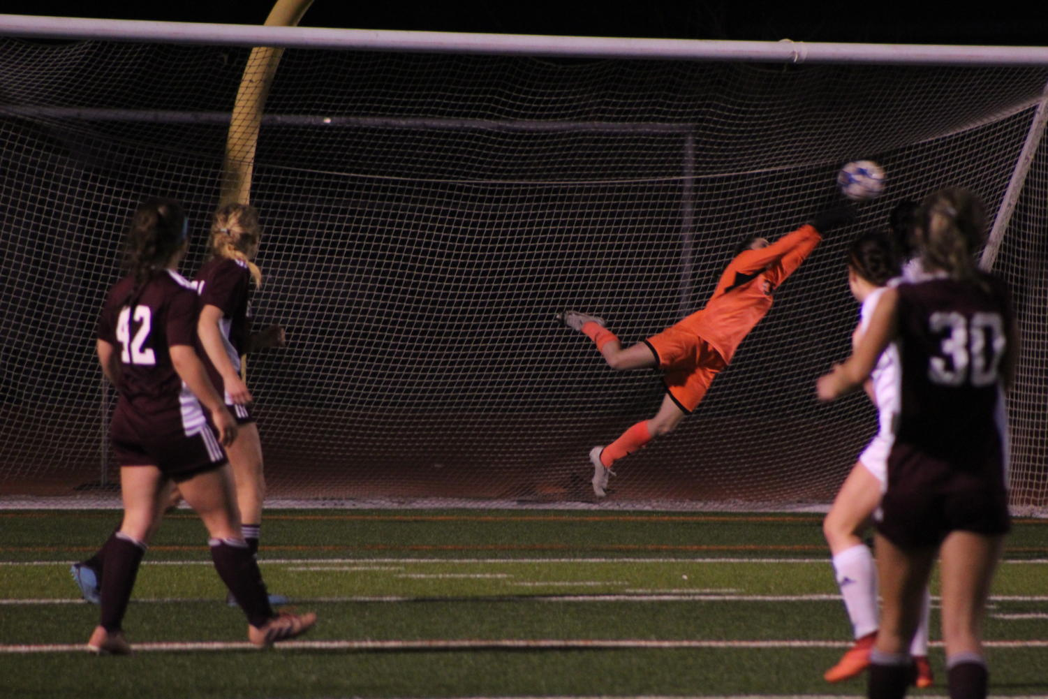 Baker makes a save as Evangel takes a shot at the goal.