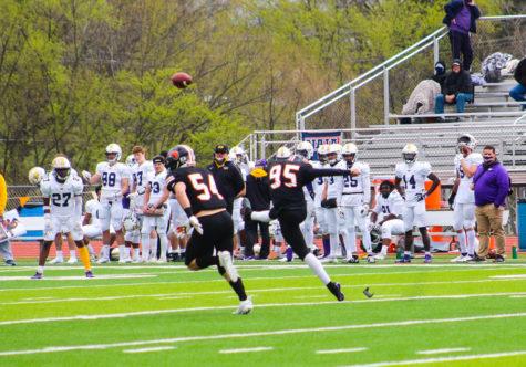 Freshman Kicker Devin Derousse attempts a field goal after a Baker touchdown.