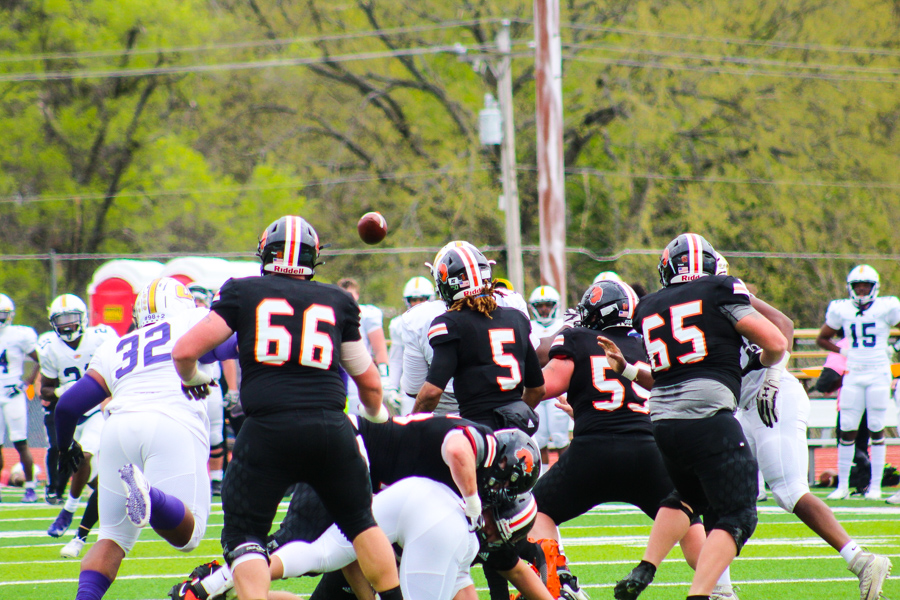 The football team in play following a pass from Senior Quarterback Marco Aguinaga.