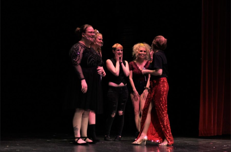 Performers from the show and MC Cassy Bailey celebrate the show's success in raising $336 from the event. The show was held on April 9 at 7 p.m.