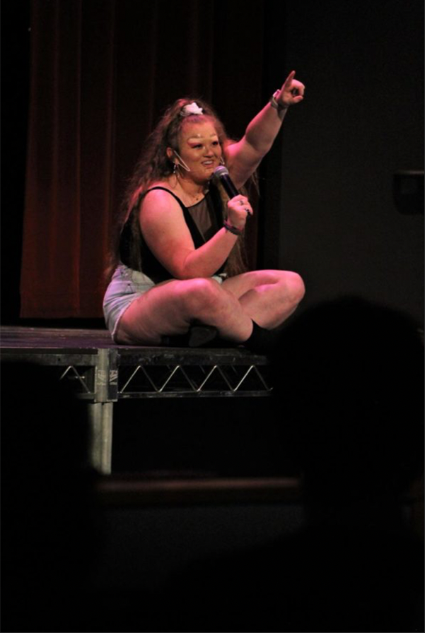 Kassie Graves, or Tess Tickles, performs a brief comedy act in Rice Auditorium.