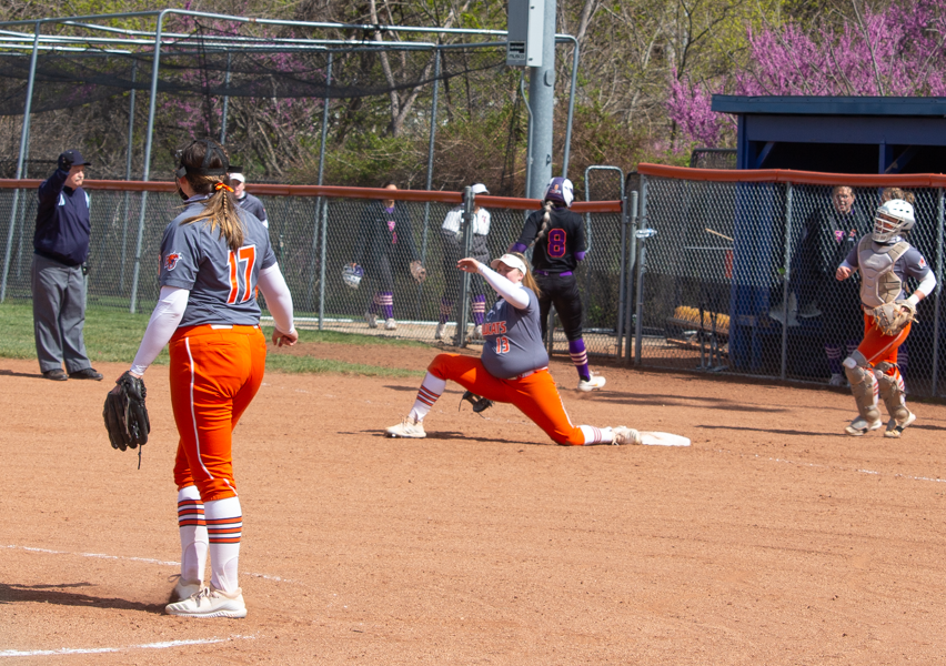 Senior First Baseman Lexi Lowrance stretches for the catch to complete the out.