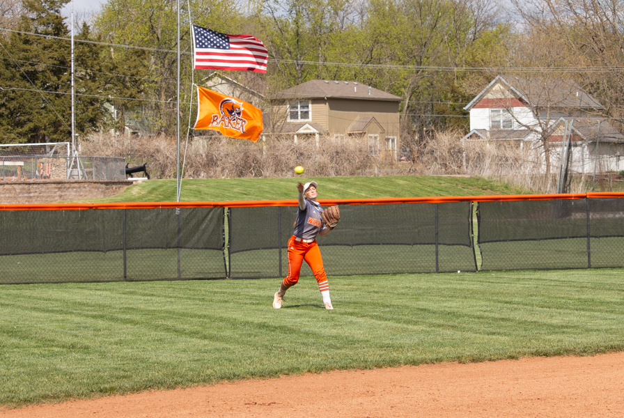 Sophomore Riley Zook throws the ball to the infield at Cavaness Field.