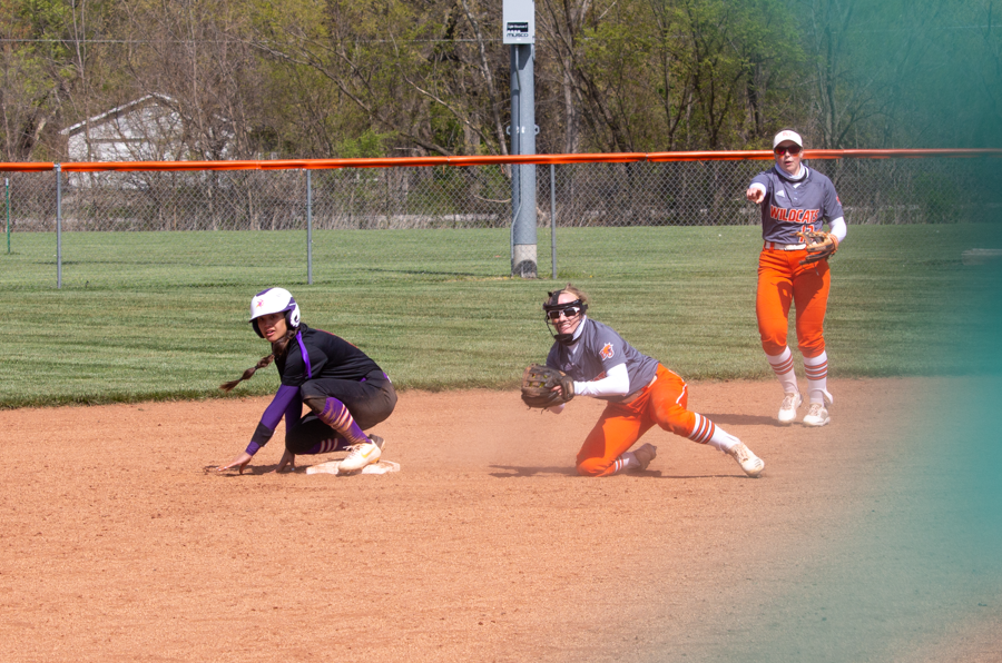 Wildcat infielders wait for a call in an attempt to complete a double-play.