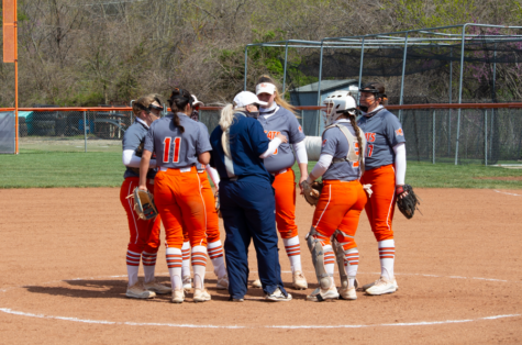 The Baker softball team joined together after the 7-1 win against Missouri Valley College.