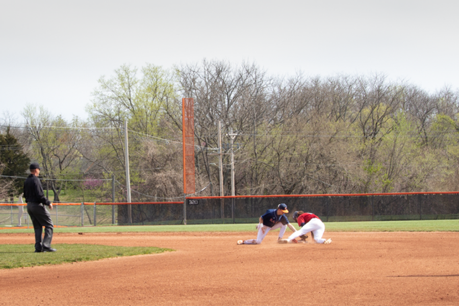 Senior Bailey Pattin races to get the runner out at second. The Wildcats went on to lose the game 1-4.