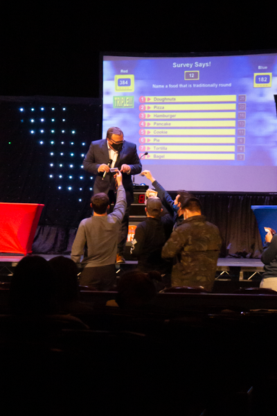 To choose the next two teams to compete, the host of the game show chooses students based off of the numbers on their cards.