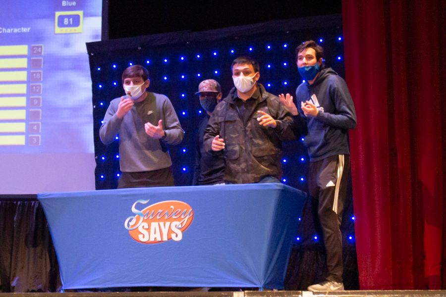 Junior Joey Ewalt (left), Freshman Noah Ackerman, Junior Jake Miller and Junior Chris Moreira look to the crowd as they prepare to answer the next survey question.