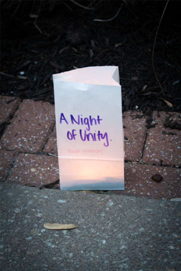 """""""A Night of Unity"""" bag is lit to show support of the event. The event was held on Wednesday, Apr. 5 at 7:30 p.m."""